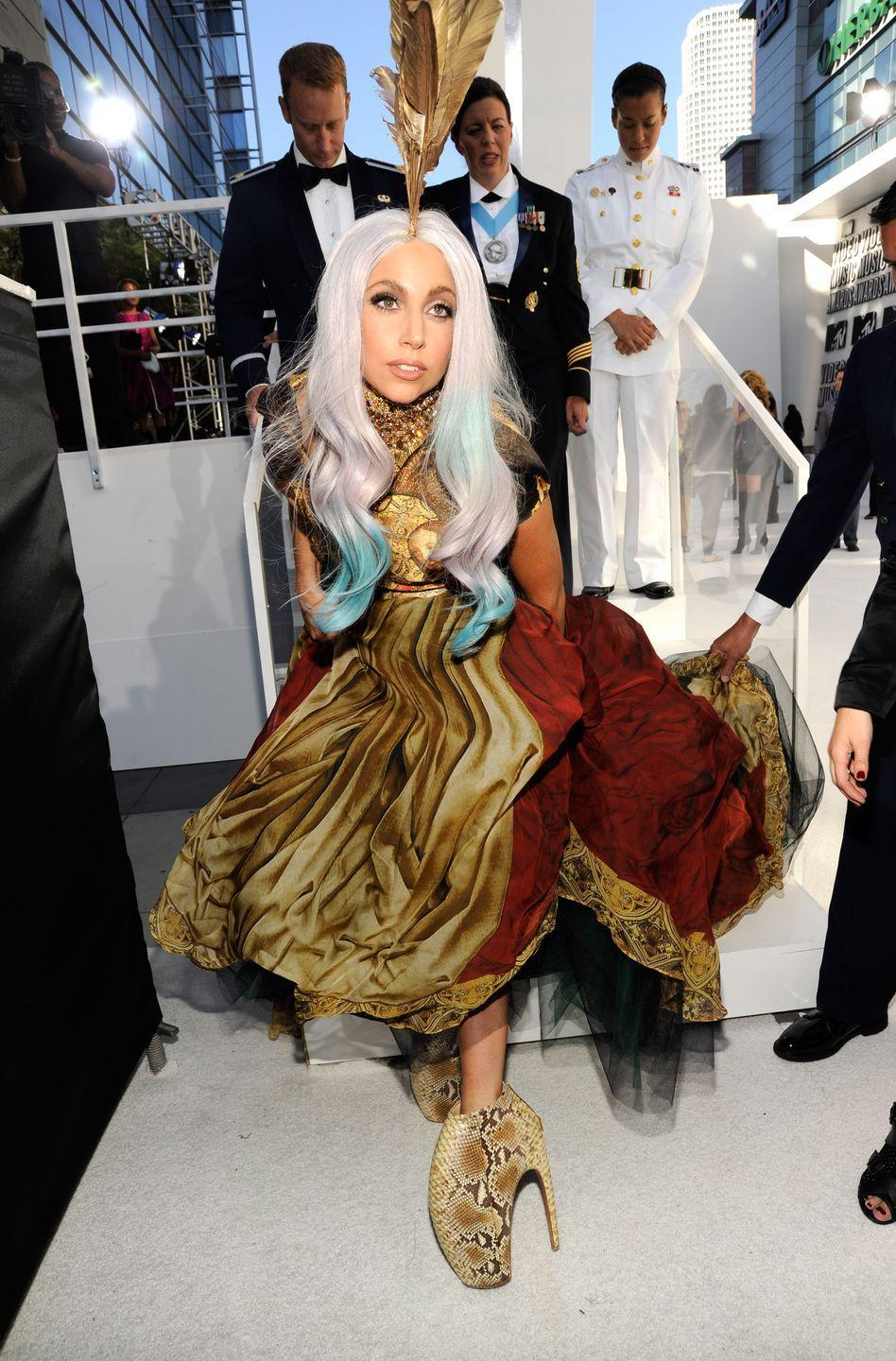 "<p>On the rise of fame, Lady Gaga <a href=""https://fashionista.com/2018/08/alexander-mcqueen-spring-2010-platos-atlantis"" rel=""nofollow noopener"" target=""_blank"" data-ylk=""slk:debuted her song"" class=""link rapid-noclick-resp"">debuted her song</a>, <em>Bad Romance,</em> at Alexander McQueen's Spring/Summer show in 2010. Models walked the runway in fantastical, 12-inch <a href=""https://www.metmuseum.org/art/collection/search/702246"" rel=""nofollow noopener"" target=""_blank"" data-ylk=""slk:Armadillo shoes"" class=""link rapid-noclick-resp"">Armadillo shoes</a> that left a lasting impression on the fashion industry. Gaga later wore the shoes in the <em>Bad Romance</em> music video, as well as on a slew of red carpets. They were the perfect accessory to her avant-garde style. </p>"
