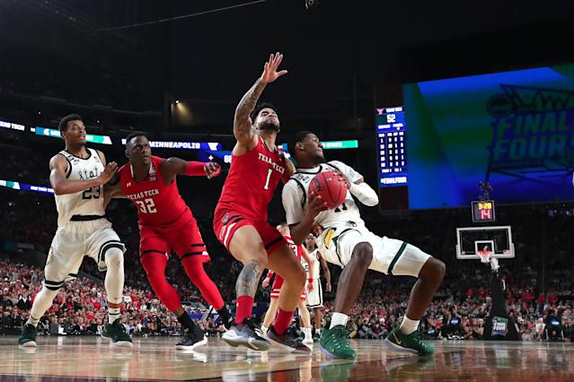 Aaron Henry #11 of the Michigan State Spartans battles for the ball with Brandone Francis #1 of the Texas Tech Red Raiders in the second half during the 2019 NCAA Final Four semifinal at U.S. Bank Stadium on April 6, 2019 in Minneapolis, Minnesota. (Photo by Tom Pennington/Getty Images)