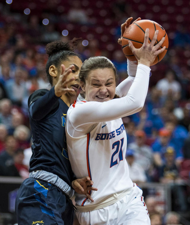 Nevada forward AJ Cephas, left, plays tight defense on Boise State guard Riley Lupfer, right, as she drives the lane during the first half of an NCAA college basketball women's championship game in the Mountain West Conference tournament Friday, March 9, 2018, in Las Vegas. (AP Photo/L.E. Baskow)