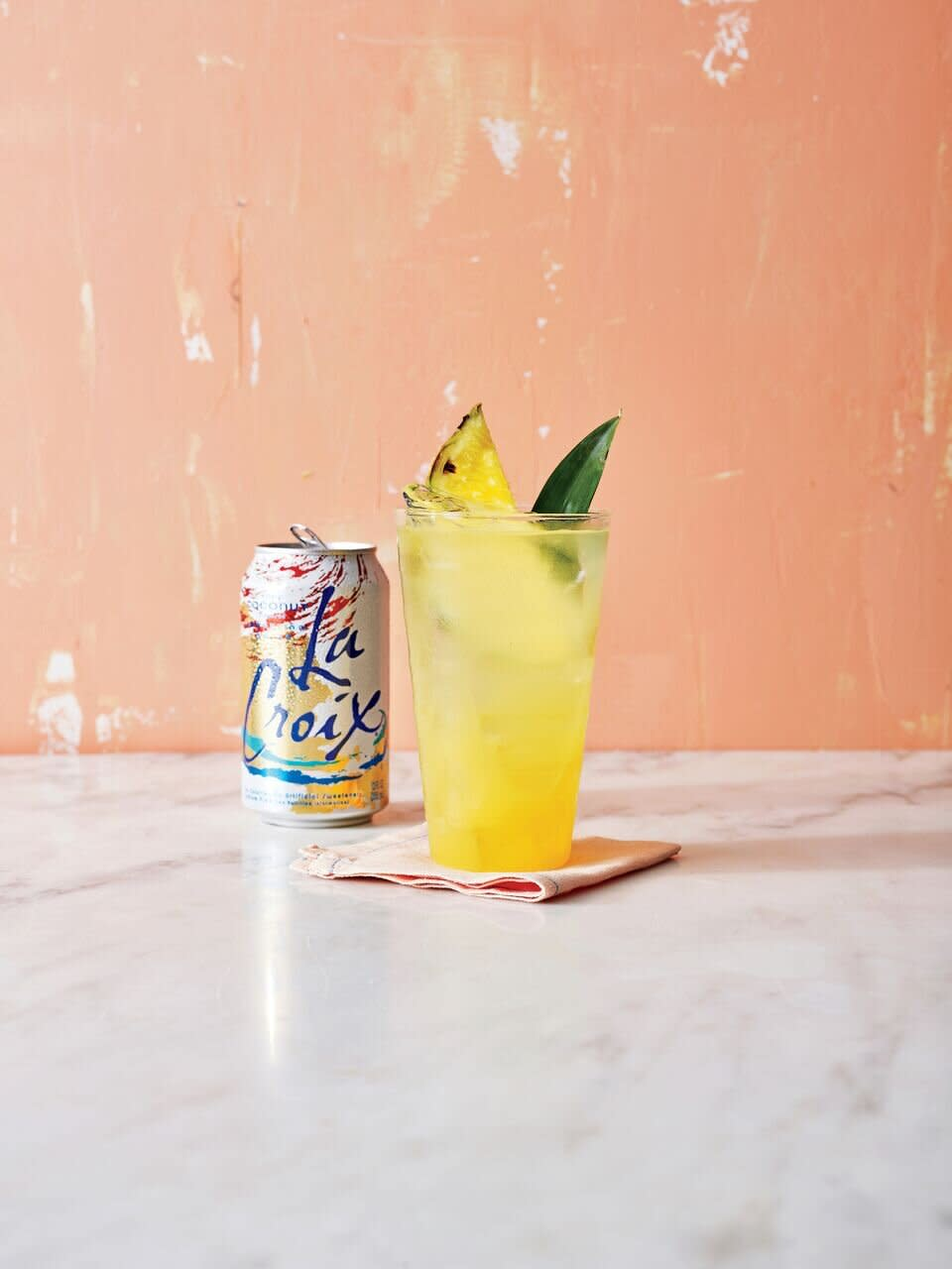 <p>Put on a little Jimmy Buffett and whip up this easy, skinny cocktail for a little taste of the islands, no matter where you are. Pineapple juice, light rum, and coconut-flavored sparkling water keep you feeling easy-breezy without all the extra calories of a traditional piña colada. </p>