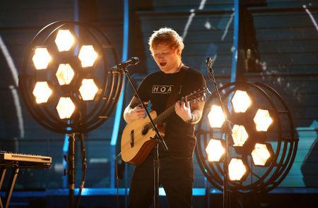 FILE PHOTO: Ed Sheeran performs at the 59th Annual Grammy Awards in Los Angeles, California, U.S., February 12, 2017. REUTERS/Lucy Nicholson/File Photo