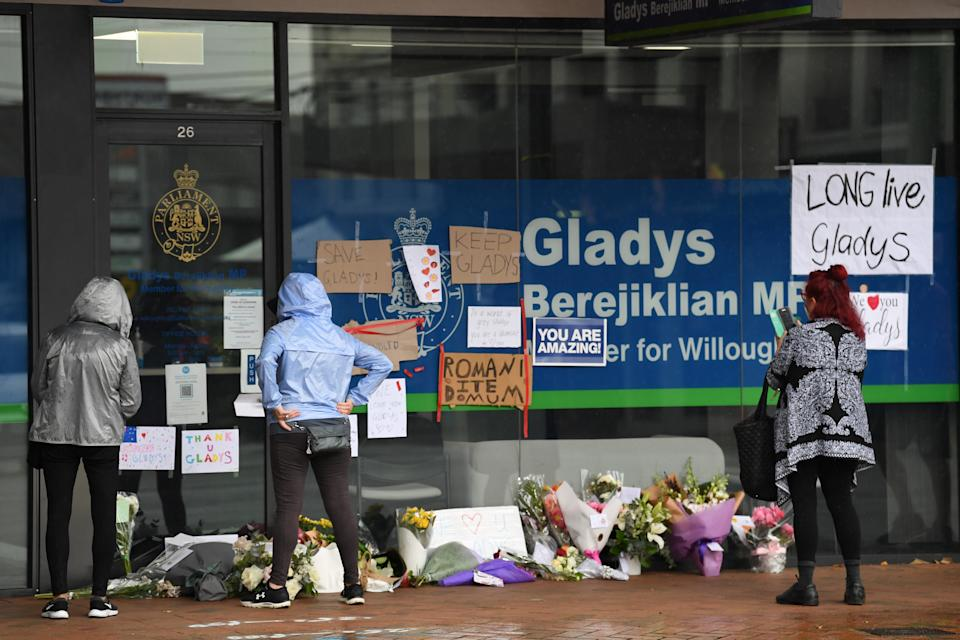 Flowers and signs are left by members of the public for Gladys Berejiklian outside her Northbridge office. Source: Getty