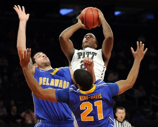 Pittsburgh's Lamar Patterson goes up with a shot as he is double-teamed by Delaware's Carl Baptiste, left, and Marvin King-Davis (21) during the first half of an NCAA college basketball in a consolation game at the NIT Season Tip-Off tournament at Madison Square Garden in New York, Friday, Nov. 23, 2012. (AP Photo/Bill Kostroun)