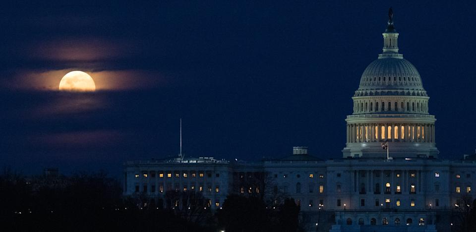 "The first supermoon of the year peers through a blanket of clouds above the U.S. Capitol in Washington in this photo captured by NASA photographer Joel Kowsky on Monday (March 9). Also known as the ""Worm Moon,"" the full moon of March nearly coincided with the moon's perigee, or the closest point to Earth in the moon's elliptical orbit. The moon was officially full on Monday at 1:48 p.m. EDT (1748 GMT), at it reached perigee almost 13 hours later, at 2:33 a.m. EDT (0633 GMT) today."
