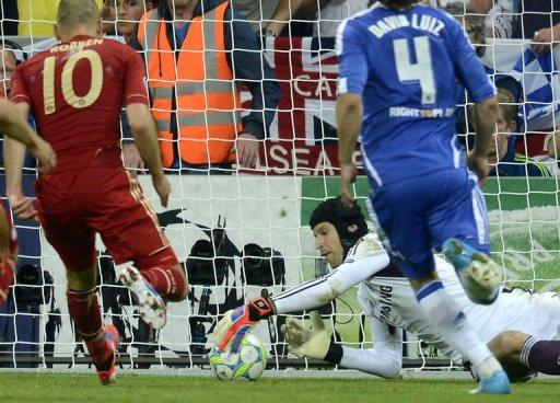 Chelsea's goalkeeper Petr Cech saves a penalty kicked by Bayern Munich's midfielder Arjen Robben during the UEFA Champions League final at the Fussball Arena stadium in Munich