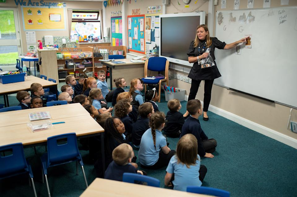 Year one pupils are taught at Willowpark Primary Academy in Oldham, northern England on September 7, 2020. - Millions of children across England have returned to school this week after the COVID-19 lockdown, with many schools introducing measures to enable as safe an environment as possible. Education Secretary Gavin Williamson said that the return of pupils to schools in England will be a 'massive milestone'. (Photo by OLI SCARFF / AFP) (Photo by OLI SCARFF/AFP via Getty Images)