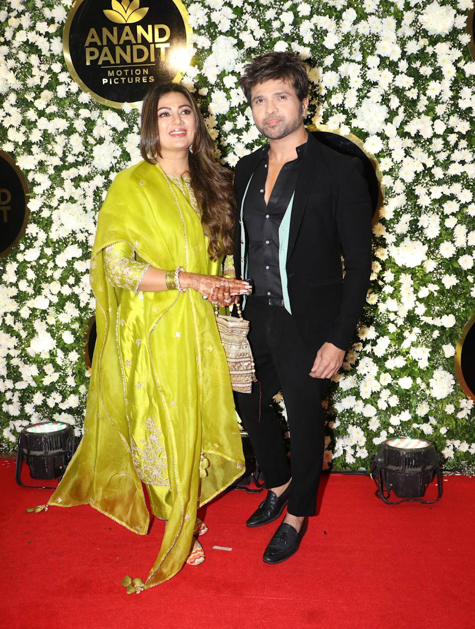 Himesh Reshamiya accompanied with his wife posing for the Diwali party.