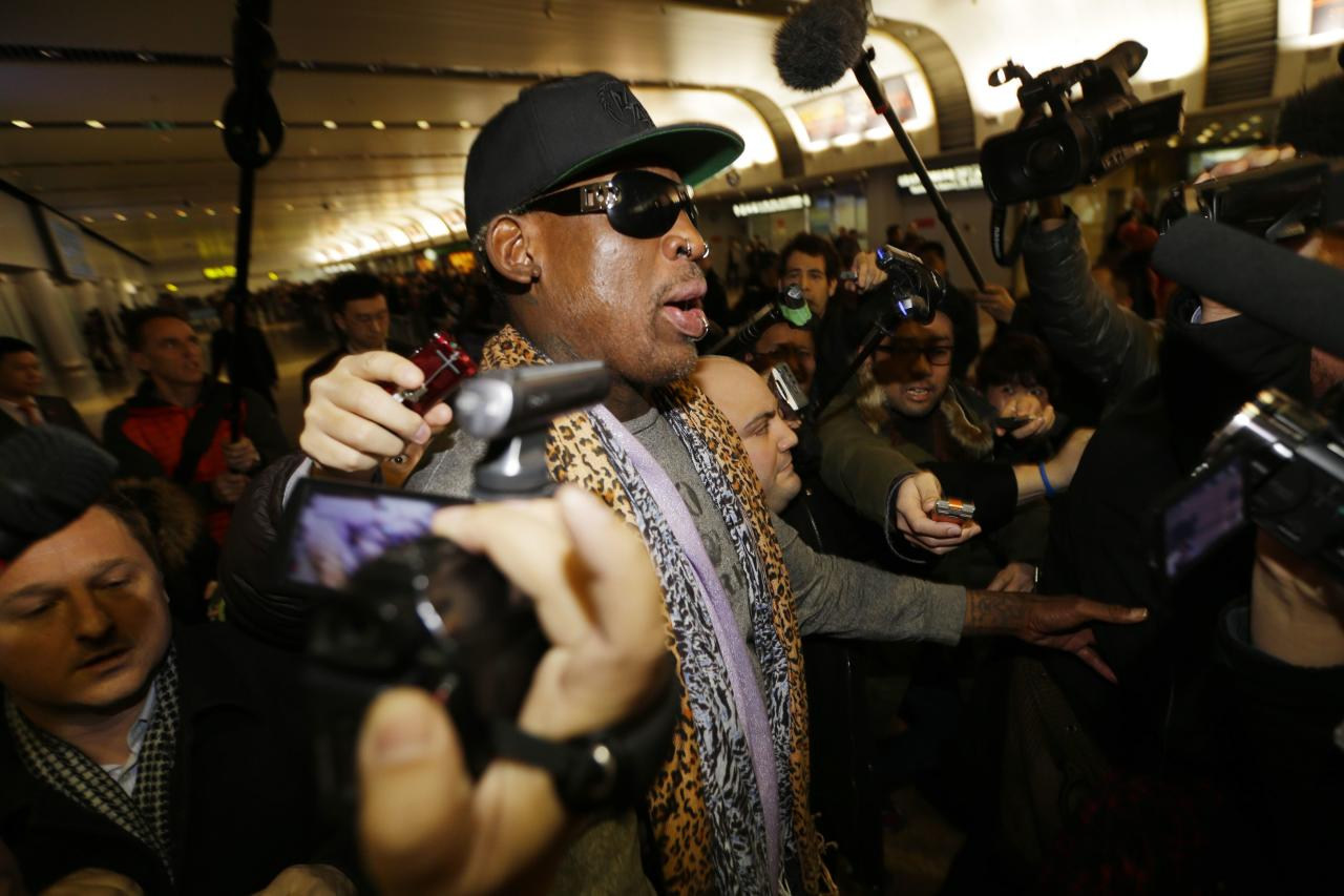 Former NBA basketball player Dennis Rodman speaks to the media as he returns from his trip to North Korea at Beijing airport, December 23, 2013. REUTERS/Jason Lee (CHINA - Tags: POLITICS SPORT)