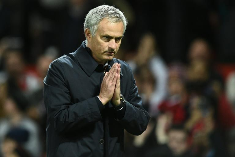 Manchester United's Portuguese manager Jose Mourinho gestures to supporters after their match against Manchester City on October 26, 2016