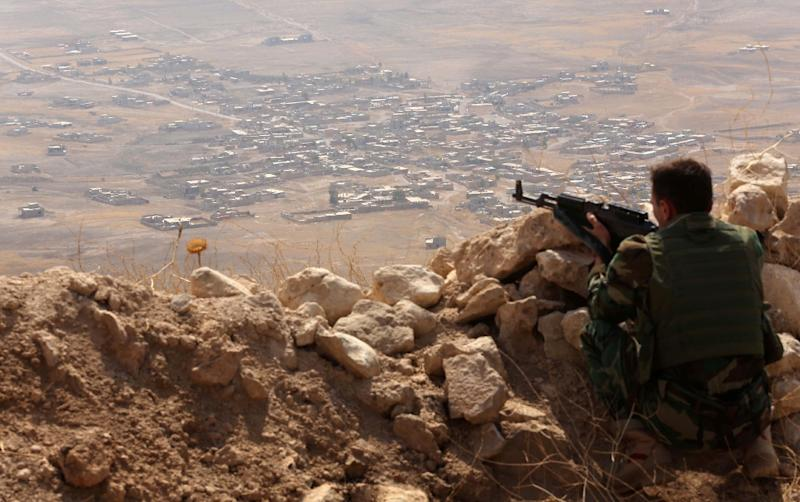An Iraqi Kurdish Peshmerga fighter keeps watch from the top of Mount Zardak, about 25 kilometres east of Mosul (AFP Photo/Safin Hamed)