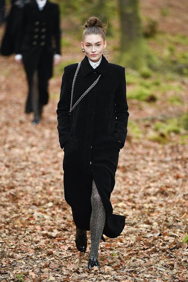 <p>The model opened up Chanel's forest-themed show in a chic black coat.</p>