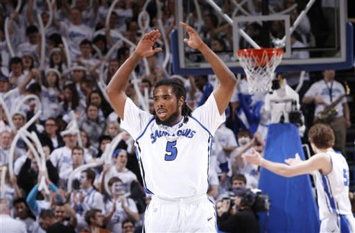 Saint Louis guard Jordair Jett encourages the crowd in the final minutes against Butler in an NCAA college basketball game Thursday, Jan. 31, 2013, in St. Louis. Saint Louis won 75-58. (AP Photo/St. Louis Post-Dispatch, Chris Lee)