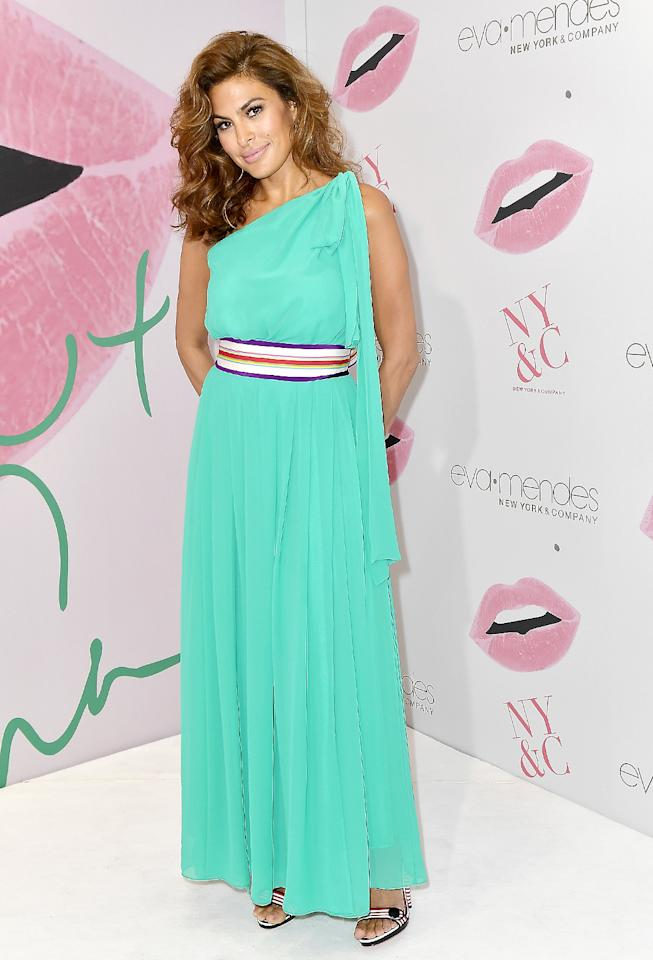 "<p>The actress stunned at the Miami opening of a New York & Company store, wearing a dress from her own collection for the retailer. The event marked <a rel=""nofollow"" href=""https://www.yahoo.com/celebrity/eva-mendes-debuts-clothing-collection-054451303.html"">the first public appearance</a> that Ryan Gosling's partner had made in six months. (Photo: Gustavo Caballero/Getty Images for New York & Company) </p>"