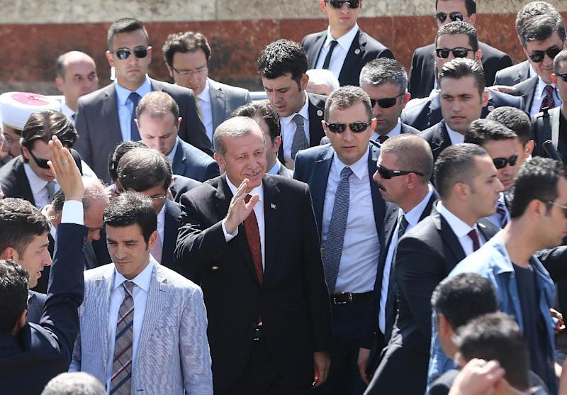 Turkey's newly elected President Recep Tayyip Erdogan (C) and newly designated Prime Minister Ahmet Davutoglu (right of Erdogan) greet the crowd in Ankara, on August 22, 2014