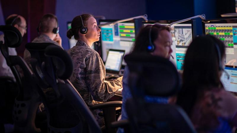 Air Force personnel at Cape Canaveral supervise the launch of a military satellite in 2019.