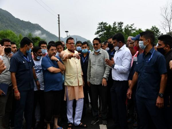 CM Pushkar Singh Dhami with the locals at the spot. (Photo/ANI)