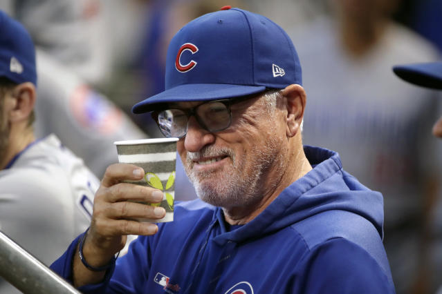 Chicago Cubs manager Joe Maddon salutes a fan from the dugout before a baseball game against the Pittsburgh Pirates in Pittsburgh, Wednesday, Sept. 25, 2019. (AP Photo/Gene J. Puskar)