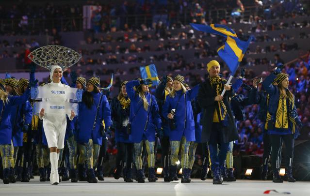 Sweden's flag-bearer Anders Soedergren leads his country's contingent during the opening ceremony of the 2014 Sochi Winter Olympic Games at Fisht stadium February 7, 2014. REUTERS/Brian Snyder (RUSSIA - Tags: OLYMPICS SPORT)