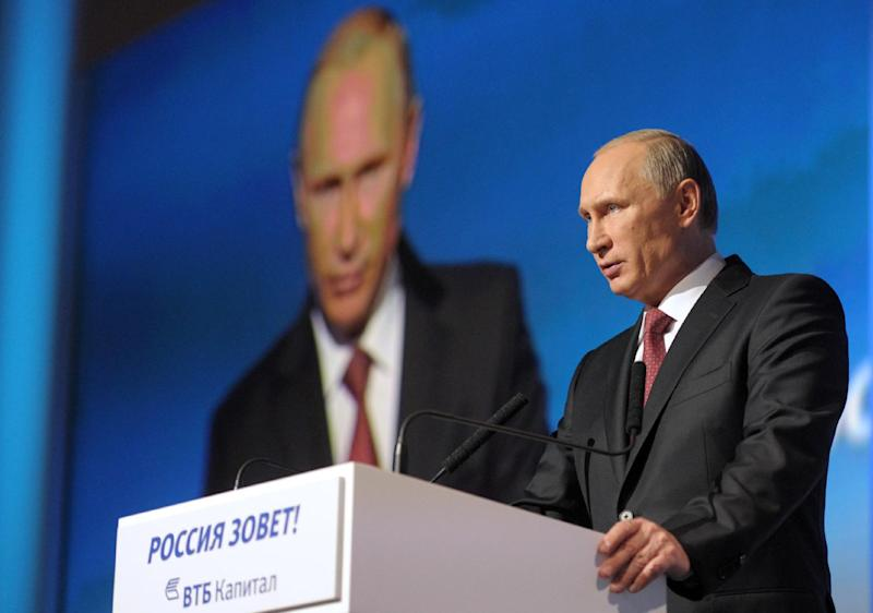 """Russian President vladimir Putin delivers a speech at the sixth annual VTB Capital """"RUSSIA CALLING!"""" Investment Forum in Moscow on October 2, 2014 (AFP Photo/Alexey Druzhinin)"""