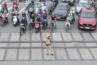 A policeman manages the traffic in Hanoi, Vietnam on Wednesday, Sept. 16, 2020. Vietnam will resume international commercial flights connecting the country to several Asian destinations after a monthslong shutdown to curb the coronavirus outbreak. (AP Photo/Hau Dinh)