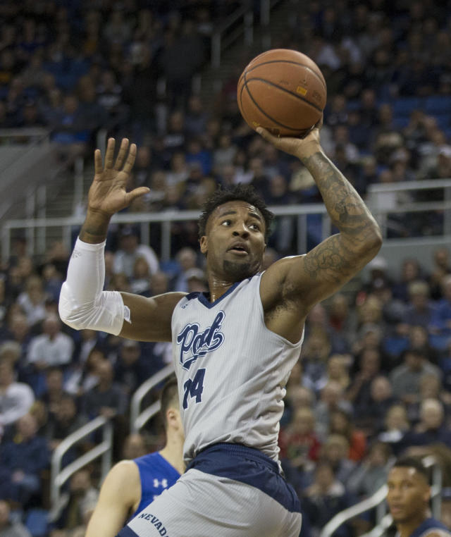 Nevada forward Jordan Caroline (24) takes a jump shot against South Dakota State in the first half of an NCAA college basketball game in Reno, Nev., Saturday, Dec. 15, 2018. (AP Photo/Tom R. Smedes)