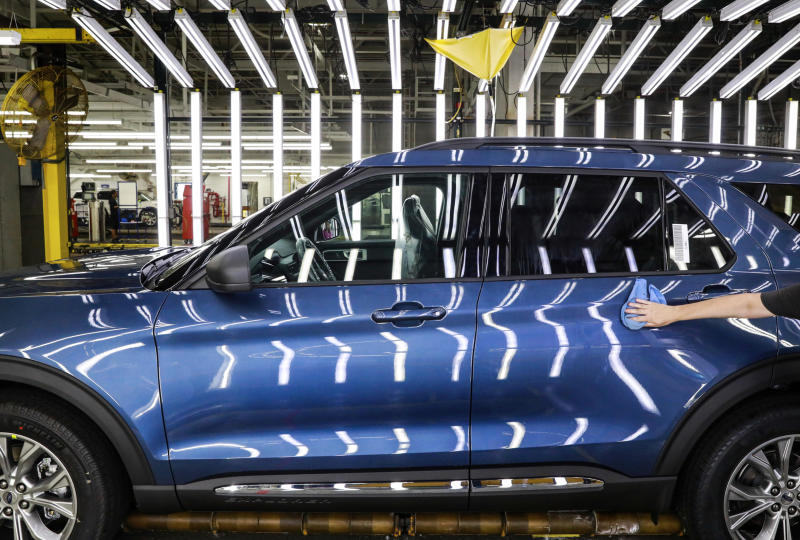 FILE - In this June 24, 2019, file photo a Ford employee works on a Ford Explorer line at Ford's Chicago Assembly Plant in Chicago's Hegewisch neighborhood. Ford Motor Co. reports earning on Wednesday, July 24, 2019. (AP Photo/Amr Alfiky, File)