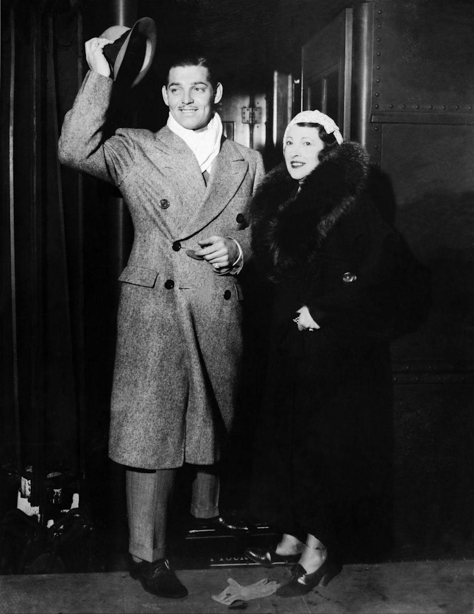 <p>American actor Clark Gable and his wife Ria Langham arriving at Grand Central terminal in New York.</p><p>Other celebrity visitors this year: Kitty Carlisle, Peggy Hopkins Joyce.</p>