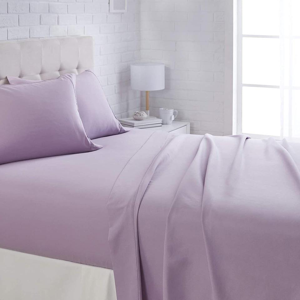 """<p>Microfiber sheets have gained popularity over the past few years for being super smooth and inexpensive. They are synthetic and use ultra-thin strands of polyester (hence the """"<em>micro</em>fiber"""" name). While some shoppers may be skeptical because they're made with polyester instead of natural fibers like <a href=""""https://www.goodhousekeeping.com/home-products/best-sheets/g25954307/best-cotton-sheets/"""" rel=""""nofollow noopener"""" target=""""_blank"""" data-ylk=""""slk:cotton"""" class=""""link rapid-noclick-resp"""">cotton</a> or <a href=""""https://www.goodhousekeeping.com/home-products/best-sheets/g25937065/best-linen-sheets/"""" rel=""""nofollow noopener"""" target=""""_blank"""" data-ylk=""""slk:linen"""" class=""""link rapid-noclick-resp"""">linen</a>, microfiber is a great option for those who prefer a <a href=""""https://www.goodhousekeeping.com/home-products/best-sheets/g27815306/softest-bed-sheets/"""" rel=""""nofollow noopener"""" target=""""_blank"""" data-ylk=""""slk:super soft"""" class=""""link rapid-noclick-resp"""">super soft</a> feel over crisp and anyone looking to spend less on their bedding. <br></p><p>Here at the <a href=""""https://www.goodhousekeeping.com/institute/about-the-institute/a19748212/good-housekeeping-institute-product-reviews/"""" rel=""""nofollow noopener"""" target=""""_blank"""" data-ylk=""""slk:Good Housekeeping Institute"""" class=""""link rapid-noclick-resp"""">Good Housekeeping Institute</a> Textiles Lab, we test <a href=""""https://www.goodhousekeeping.com/home-products/best-sheets/g3038/best-sheets-reviews/"""" rel=""""nofollow noopener"""" target=""""_blank"""" data-ylk=""""slk:sheets of all kinds"""" class=""""link rapid-noclick-resp"""">sheets of all kinds</a> to find the best sets for every preference, from <a href=""""https://www.goodhousekeeping.com/home-products/best-sheets/g27482059/best-cooling-sheets/"""" rel=""""nofollow noopener"""" target=""""_blank"""" data-ylk=""""slk:cooling sheets"""" class=""""link rapid-noclick-resp"""">cooling sheets</a> for hot sleepers, to warm and cozy <a href=""""https://www.goodhousekeeping.com/home-products/best-sheets/g25361996/best-flannel-sheets"""