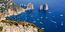 """<p>The Roman emperor Tiberius was so transfixed by the beauty of Capri, off the coast of Naples, he transferred his imperial household here in A.D. 27. It's still as stunning today, with sea caves, such as the beautiful <a href=""""https://go.redirectingat.com?id=74968X1596630&url=https%3A%2F%2Fwww.tripadvisor.com%2FAttraction_Review-g488299-d195537-Reviews-Blue_Grotto-Anacapri_Island_of_Capri_Province_of_Naples_Campania.html&sref=https%3A%2F%2Fwww.redbookmag.com%2Flife%2Fg36983737%2Fmost-beautiful-islands-in-the-world%2F"""" rel=""""nofollow noopener"""" target=""""_blank"""" data-ylk=""""slk:Blue Grotto"""" class=""""link rapid-noclick-resp"""">Blue Grotto</a>, limestone cliffs, and olive groves — not to mention chic cafes and designer shops. </p>"""