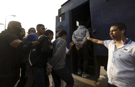 Police detain students in al-Azhar university after student protests in Cairo October 30, 2013. REUTERS/Mohamed Abd El Ghany