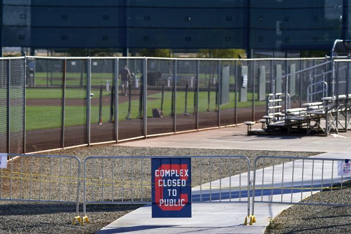 The entrances to the Cleveland Indians spring training facility are closed to the public due to the ongoing COVID-19 outbreak prior to the first day of full squad spring training baseball practice Monday, Feb. 22, 2021, in Goodyear, Ariz. (AP Photo/Ross D. Franklin)