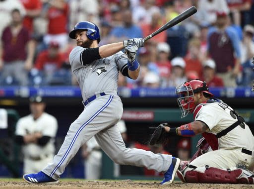 Toronto Blue Jays' Russell Martin hits a single to score Justin Smoak off Philadelphia Phillies' Aaron Nola during the seventh inning of a baseball game, Saturday, May 26, 2018, in Philadelphia. (AP Photo/Derik Hamilton)