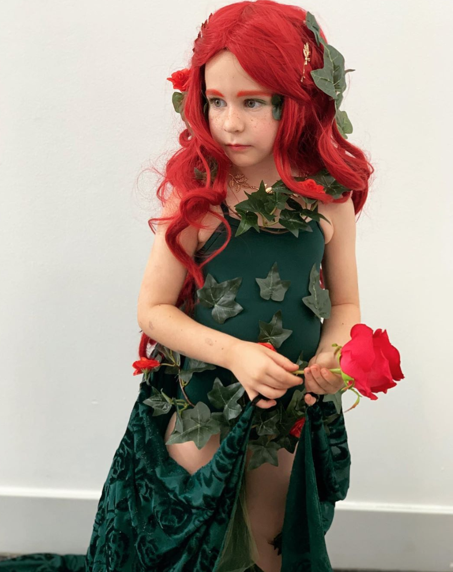 """<p>Help your tot look preciously poisonous with this simple DIY. All you have to do is layer faux ivy over a green leotard, and pair it with a dark green cape and red wig for a Halloween-ready ensemble.</p><p><strong>See more at </strong><a href=""""https://www.instagram.com/p/B0tvMkEjBPS/"""" rel=""""nofollow noopener"""" target=""""_blank"""" data-ylk=""""slk:@MissEllieHoneyBee"""" class=""""link rapid-noclick-resp""""><strong>@MissEllieHoneyBee</strong></a><strong>. </strong></p><p><a class=""""link rapid-noclick-resp"""" href=""""https://www.amazon.com/California-Costumes-Womens-Lethal-Beauty/dp/B00DQ3SHIU/ref=asc_df_B00DQ3SHIU/?tag=syn-yahoo-20&ascsubtag=%5Bartid%7C10050.g.29402429%5Bsrc%7Cyahoo-us"""" rel=""""nofollow noopener"""" target=""""_blank"""" data-ylk=""""slk:SHOP RED WIGS""""><strong>SHOP RED WIGS</strong></a></p>"""
