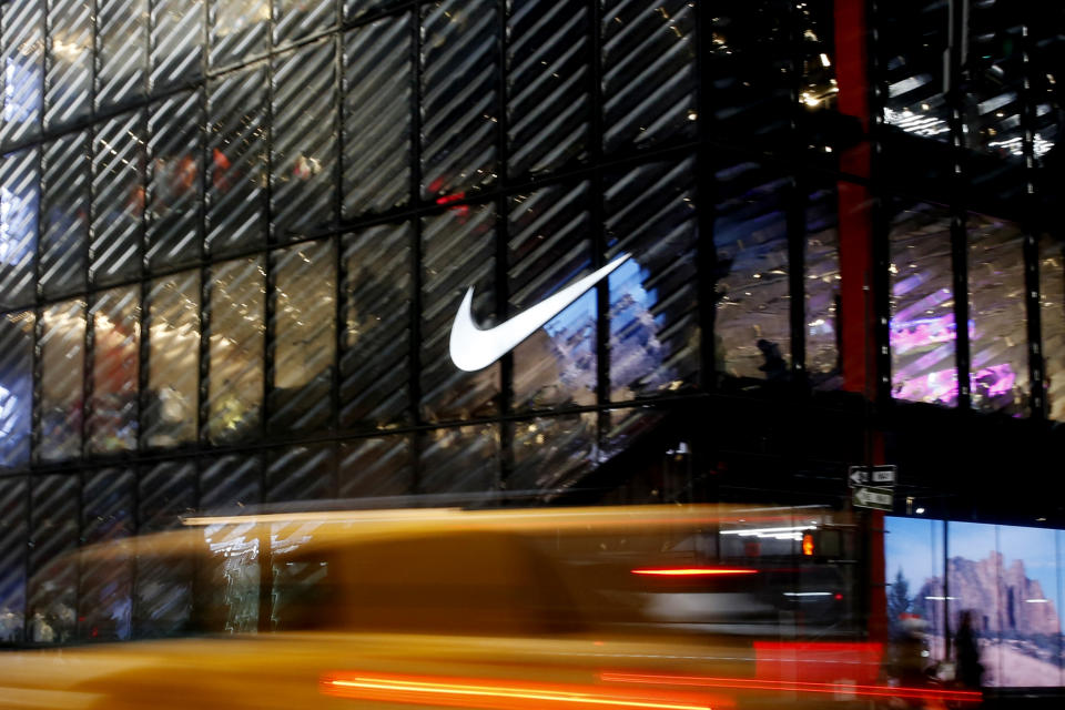 NEW YORK, NEW YORK - FEBRUARY 22: A Taxi crosses in front of the Nike store on February 22, 2021 in New York City. NIKE, Inc. (NYSE: NKE) will trade ex-dividend in the next days as NIKE's earnings have been almost flat over the past five years.  (Photo by John Smith/VIEWpress via Getty Images)