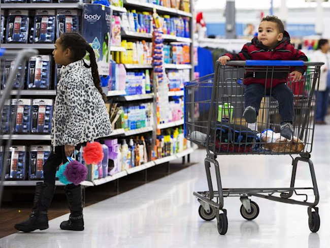 A girl walks away from a child in a shopping cart while her family looks through a Walmart store in Secaucus, New Jersey, November 11, 2015. REUTERS/Lucas Jackson