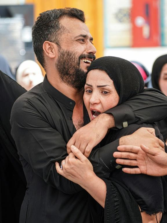 Grief-stricken mourners at a funeral in Najaf on July 13, 2021, for relatives who died in the Nasiriyah fire