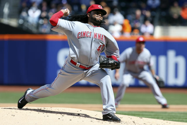 Cincinnati Reds starting pitcher Johnny Cueto throws in the first inning of a baseball game against the New York Mets at Citi Field, Saturday, April 5, 2014, in New York. (AP Photo/John Minchillo)