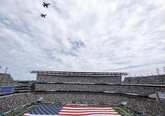 <p>A fly over the field as the American Flag is held during the National Anthem before an NFL football game between the Philadelphia Eagles and the Cleveland Browns, Sunday, Sept. 11, 2016, in Philadelphia. (AP Photo/Chris Szagola) </p>