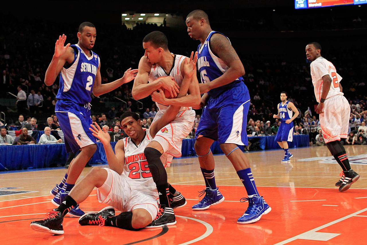 NEW YORK, NY - MARCH 07:  Jared Swopshire #21 and Wayne Blackshear #25 of the Louisville Cardinals fight for a loose ball against Brandon Mobley #2 and Herb Pope #15 of the Seton Hall Pirates during their second round game of the Big East Men's Basketball Tournament at Madison Square Garden on March 7, 2012 in New York City.  (Photo by Chris Trotman/Getty Images)