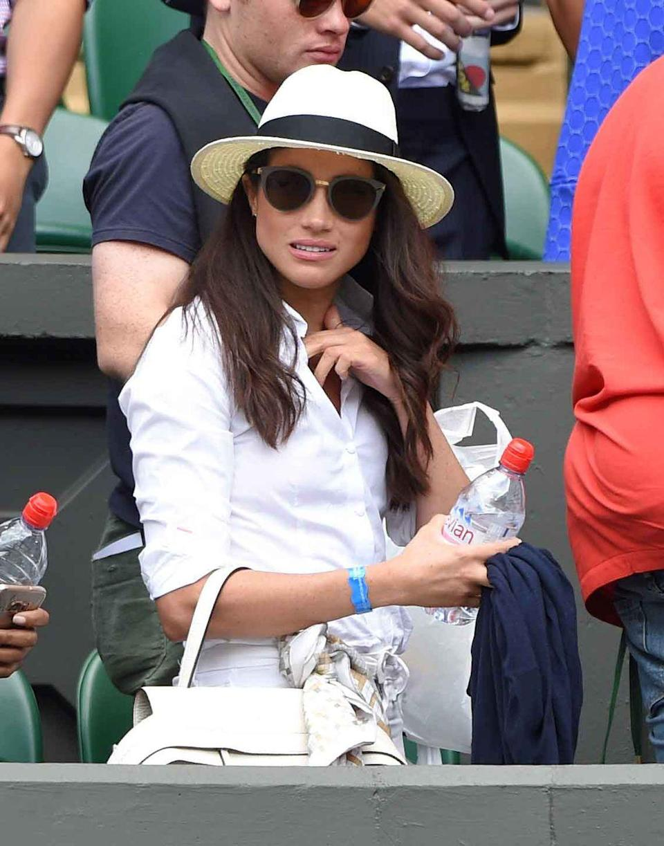 <p>Sporting a panama hat at the Wimbledon Tennis Championships in London, England.</p>