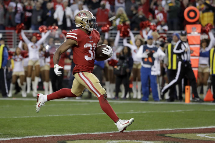 San Francisco 49ers running back Raheem Mostert scores against the Green Bay Packers during the first half of the NFL NFC Championship football game Sunday, Jan. 19, 2020, in Santa Clara, Calif. (AP Photo/Marcio Jose Sanchez)