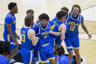 UCLA players celebrate following an 86-80 win over Michigan State in a First Four game in the NCAA men's college basketball tournament, early Friday, March 19, 2021, at Mackey Arena in West Lafayette, Ind. (AP Photo/Robert Franklin)