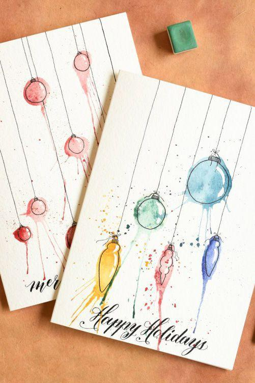 """<p>Get in touch with your artistic side! Though watercolor painting may sound intimidating, the messier and more expressive you are, the better this design will look.</p><p><strong>Get the tutorial at <a href=""""https://thepostmansknock.com/artistic-ornaments-themed-diy-christmas-card-tutorial/"""" rel=""""nofollow noopener"""" target=""""_blank"""" data-ylk=""""slk:The Postman's Knock"""" class=""""link rapid-noclick-resp"""">The Postman's Knock</a>.</strong></p><p><a class=""""link rapid-noclick-resp"""" href=""""https://www.amazon.com/Watercolor-Variety-Quality-Brushes-Everything/dp/B01G7KHNWE/?tag=syn-yahoo-20&ascsubtag=%5Bartid%7C10050.g.3872%5Bsrc%7Cyahoo-us"""" rel=""""nofollow noopener"""" target=""""_blank"""" data-ylk=""""slk:SHOP WATERCOLORS"""">SHOP WATERCOLORS</a><br></p>"""