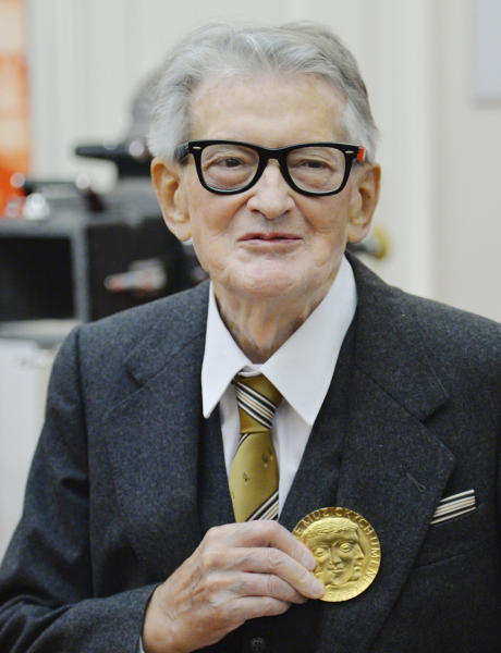 FILE - In this November 30, 2015, file photo, Vojtech Jasny, Czech film director and scriptwriter, poses for photographers as he receives gold medal of Academy of Performing Arts in Prague (AMU) on the occasion of his 90th birthday and AMUs 70th anniversary in Prague, Czech Republic. Vojtech Jasny has died on Friday, Nov. 15, 2019, at the age of 93 years. (Michal Dolezal/CTK via AP)