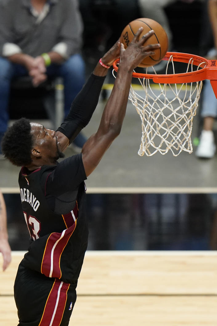 Miami Heat center Bam Adebayo dunks during the second half of an NBA basketball game against the Brooklyn Nets, Sunday, April 18, 2021, in Miami. (AP Photo/Wilfredo Lee)