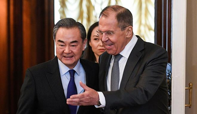 Russian Foreign Minister Sergey Lavrov (right) told his Chinese counterpart Wang Yi (left) that Russia also opposed unilateralism. Photo: AFP