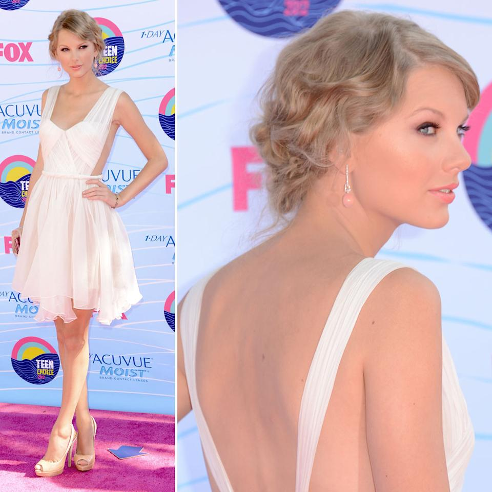"Taylor Swift stunned the crowed upon arrival at the 2012 Teen choice Awards in a short, white Maria Lucia Hoan backless dress, which showed off her mile-long gams. The 22-year-old songstress wore her hair swept up in a chic updo and accessorized the romantic  frock with Lorraine Schwartz jewels, a sparkly Edie Parker clutch, and nude Prada shoes. There's no denying that the country cutie looked gorgeous, but we can't help but think it's a drawback that she's always wearing white to awards shows. Along with presenting, Taylor is nominated for five awards this year : Choice Voice for ""The Lorax,"" Choice Female Artist, Choice Single by a Female Artist for ""Eyes Open,"" Choice Female Country Artist, and Choice Country Song for ""Sparks Fly."""