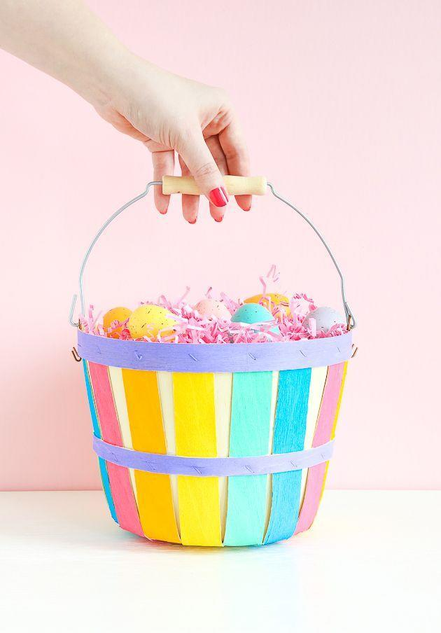"""<p>Let your kids unleash their creativity by painting their own wooden Easter basket with the colors of the rainbow. </p><p><a class=""""link rapid-noclick-resp"""" href=""""https://www.amazon.com/Cornucopia-Brands-Baskets-Natural-Capacity/dp/B07Q58PFL7/?tag=syn-yahoo-20&ascsubtag=%5Bartid%7C10055.g.480%5Bsrc%7Cyahoo-us"""" rel=""""nofollow noopener"""" target=""""_blank"""" data-ylk=""""slk:SHOP WOODEN BASKETS"""">SHOP WOODEN BASKETS</a></p><p><em><a href=""""https://thecraftedlife.com/diy-painted-easter-basket/"""" rel=""""nofollow noopener"""" target=""""_blank"""" data-ylk=""""slk:Get the tutorial at The Crafted Life »"""" class=""""link rapid-noclick-resp"""">Get the tutorial at The Crafted Life »</a></em> </p>"""