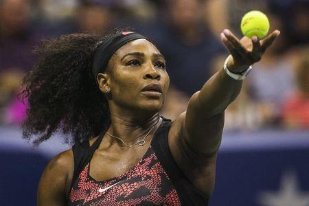Serena Williams of the U.S. serves to Vitalia Diatchenko of Russia during their match at the U.S. Open Championships tennis tournament in New York, August 31, 2015. REUTERS/Lucas Jackson