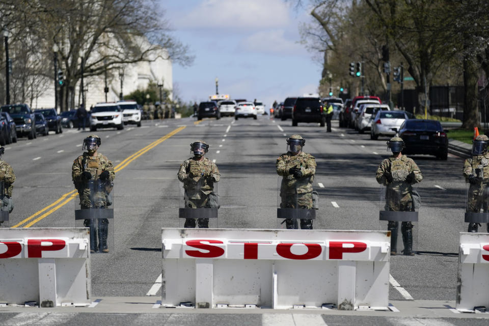 National Guard troops stand guard after a car that crashed into a barrier on Capitol Hill in Washington, Friday, April 2, 2021. (AP Photo/Carolyn Kaster)